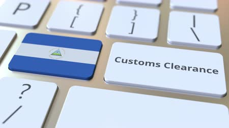 economics : CUSTOMS CLEARANCE text and flag of Nicaragua on the buttons on the computer keyboard. Import or export related conceptual 3D animation