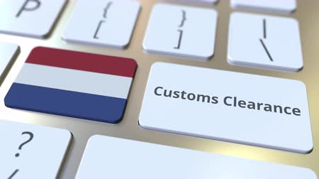 tariff : CUSTOMS CLEARANCE text and flag of the Netherlands on the computer keyboard. Import or export related conceptual 3D animation
