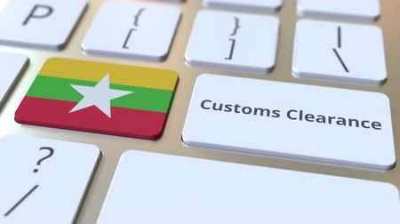 peage : CUSTOMS CLEARANCE text and flag of Myanmar on the buttons on the computer keyboard. Import or export related conceptual 3D animation Vidéos Libres De Droits
