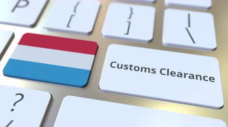 kötelesség : CUSTOMS CLEARANCE text and flag of Luxembourg on the buttons on the computer keyboard. Import or export related conceptual 3D animation