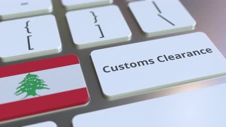 gümrük : CUSTOMS CLEARANCE text and flag of Lebanon on the computer keyboard. Import or export related conceptual 3D animation Stok Video