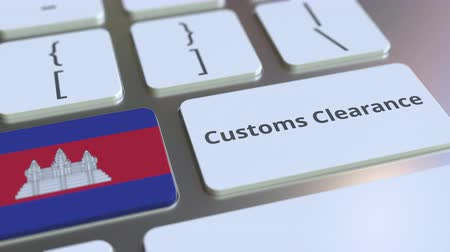 cambojano : CUSTOMS CLEARANCE text and flag of Cambodia on the buttons on the computer keyboard. Import or export related conceptual 3D animation