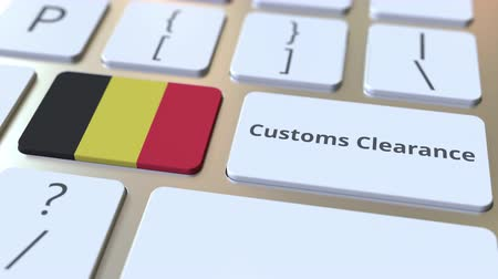 義務 : CUSTOMS CLEARANCE text and flag of Belgium on the buttons on the computer keyboard. Import or export related conceptual 3D animation