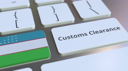 tariff : CUSTOMS CLEARANCE text and flag of Uzbekistan on the buttons on the computer keyboard. Import or export related conceptual 3D animation Stock Footage