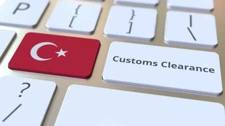 tariff : CUSTOMS CLEARANCE text and flag of Turkey on the computer keyboard. Import or export related conceptual 3D animation