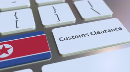 dprk : CUSTOMS CLEARANCE text and flag of North Korea on the computer keyboard. Import or export related conceptual 3D animation