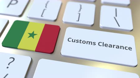 tariff : CUSTOMS CLEARANCE text and flag of Senegal on the computer keyboard. Import or export related conceptual 3D animation