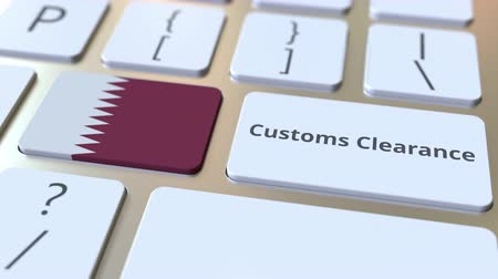 yabancı : CUSTOMS CLEARANCE text and flag of Qatar on the computer keyboard. Import or export related conceptual 3D animation Stok Video