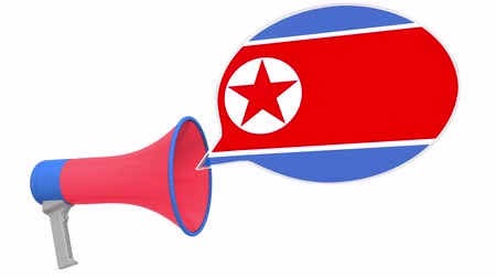 aksan : Megaphone and flag of North Korea on the speech balloon. Language or national statement related conceptual 3D animation Stok Video