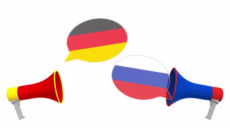 мегафон : Flags of Russia and Germany on speech bubbles with loudspeakers. Intercultural dialogue or international talks related 3D animation