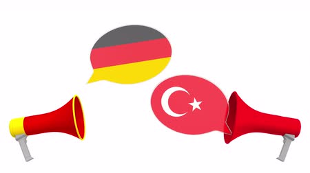megafon : Speech bubbles with flags of Turkey and Germany. Intercultural dialogue or international talks related 3D animation
