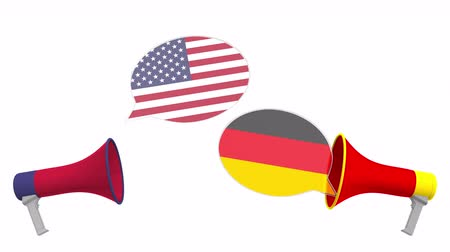 political speech : Speech bubbles with flags of Germany and the USA and loudspeakers. Intercultural dialogue or international talks related 3D animation Stock Footage
