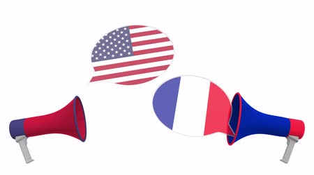 multikulturális : Flags of France and the USA on speech balloons from megaphones. Intercultural dialogue or international talks related 3D animation Stock mozgókép