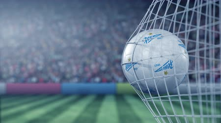 zenit : Ball with Zenit Saint Petersburg football club logo hits football goal net. Conceptual editorial 3D animation Stock Footage