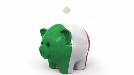 kuruş : Coins fall into piggy bank painted with flag of Italy. National banking system or savings related conceptual 3D animation Stok Video
