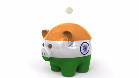 kuruş : Coins fall into piggy bank painted with flag of India. National banking system or savings related conceptual 3D animation
