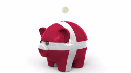 centavo : Coins fall into piggy bank painted with flag of Denmark. National banking system or savings related conceptual 3D animation