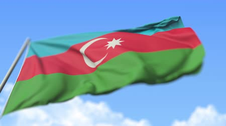 high rises : Flying national flag of Azerbaijan, low angle view. Loopable realistic slow motion 3D animation