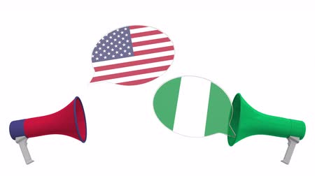 nigeria flag : Flags of Nigeria and the USA on speech bubbles with loudspeakers. Intercultural dialogue or international talks related 3D animation