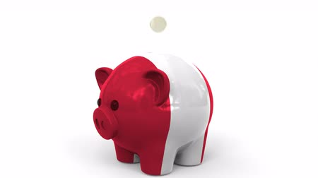 perui : Coins fall into piggy bank painted with flag of Peru. National banking system or savings related conceptual 3D animation