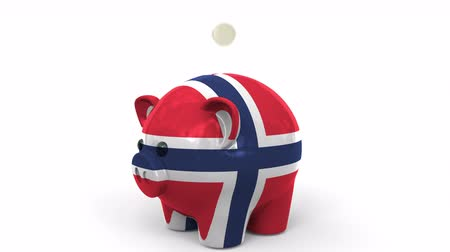 kuruş : Coins fall into piggy bank painted with flag of Norway. National banking system or savings related conceptual 3D animation