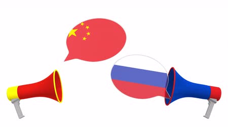 debata : Flags of Russia and China on speech bubbles with loudspeakers. Intercultural dialogue or international talks related 3D animation