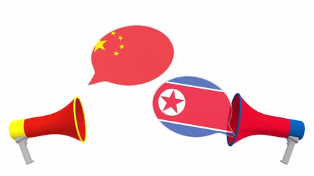 political speech : Speech bubbles with flags of North Korea and China. Intercultural dialogue or international talks related 3D animation Stock Footage
