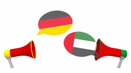 debat : Flags of the UAE and Germany on speech balloons from megaphones. Intercultural dialogue or international talks related 3D animation Stockvideo