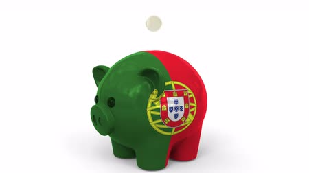 centavo : Coins fall into piggy bank painted with flag of Portugal. National banking system or savings related conceptual 3D animation