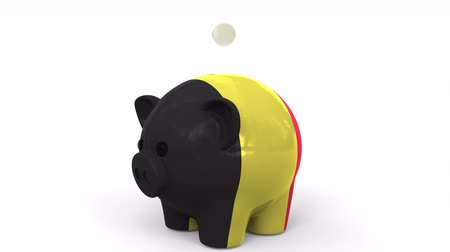 kuruş : Coins fall into piggy bank painted with flag of Belgium. National banking system or savings related conceptual 3D animation