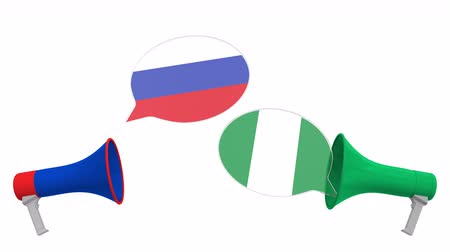 nigeria flag : Flags of Nigeria and Russia on speech bubbles with loudspeakers. Intercultural dialogue or international talks related 3D animation