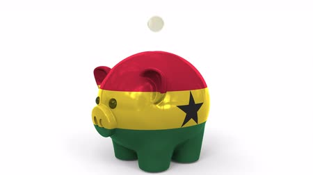 penny : Coins fall into piggy bank painted with flag of Ghana. National banking system or savings related conceptual 3D animation Stock Footage