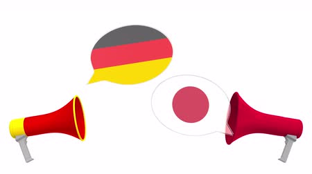 мегафон : Speech bubbles with flags of Japan and Germany. Intercultural dialogue or international talks related 3D animation Стоковые видеозаписи