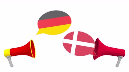 デンマーク語 : Speech bubbles with flags of Denmark and Germany and loudspeakers. Intercultural dialogue or international talks related 3D animation
