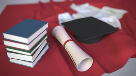 mortarboard : Graduation cap, books and diploma on the Swiss flag. Higher education in Switzerland related conceptual 3D animation Stock Footage