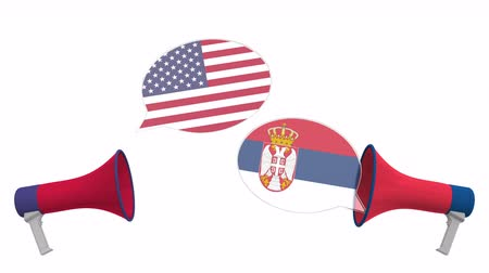 vita : Speech bubbles with flags of Serbia and the USA and loudspeakers. Intercultural dialogue or international talks related 3D animation Stock mozgókép