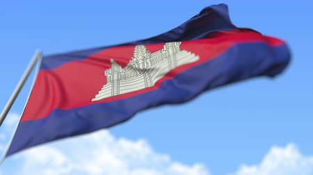 kamboçyalı : Waving national flag of Cambodia, low angle view. Loopable realistic slow motion 3D animation
