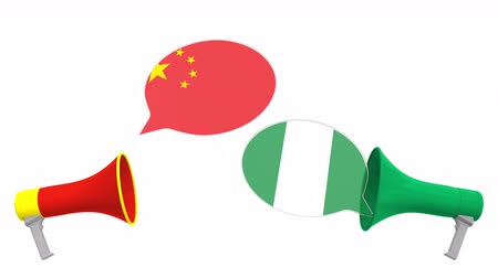 мегафон : Flags of Nigeria and China on speech bubbles with loudspeakers. Intercultural dialogue or international talks related 3D animation