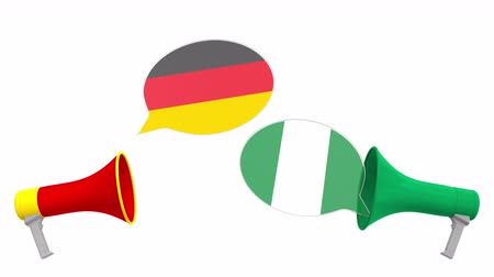 nigeria flag : Flags of Nigeria and Germany on speech bubbles with loudspeakers. Intercultural dialogue or international talks related 3D animation