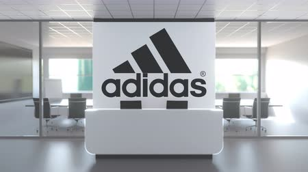 oficial : Logo of ADIDAS on a wall in the modern office, editorial conceptual 3D animation