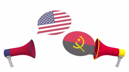 утверждение : Speech bubbles with flags of Angola and the USA. Intercultural dialogue or international talks related 3D animation Стоковые видеозаписи