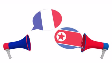 мегафон : Speech bubbles with flags of North Korea and France. Intercultural dialogue or international talks related 3D animation Стоковые видеозаписи
