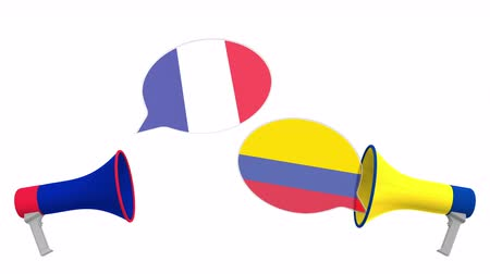 debat : Flags of Colombia and France on speech bubbles with loudspeakers. Intercultural dialogue or international talks related 3D animation Stockvideo