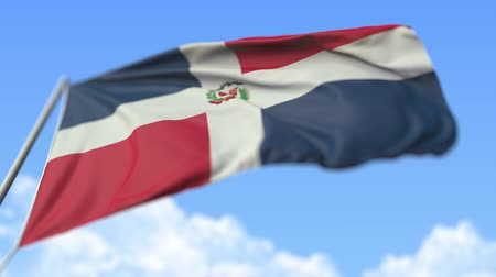 high rises : Flying national flag of the Dominican Republic, low angle view. Loopable realistic slow motion 3D animation