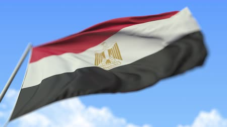 aşağıda : Waving national flag of Egypt, low angle view. Loopable realistic slow motion 3D animation