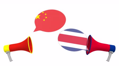 vita : Speech bubbles with flags of Costa rica and China and loudspeakers. Intercultural dialogue or international talks related 3D animation Stock mozgókép