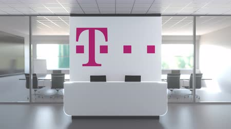 oficial : Logo of DEUTSCHE TELEKOM AG on a wall in the modern office, editorial conceptual 3D animation