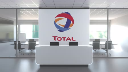 celkový : TOTAL logo in modern office and a meeting room, editorial conceptual 3D animation
