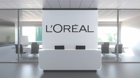 lápide : Logo of LOREAL on a wall in the modern office, editorial conceptual 3D animation