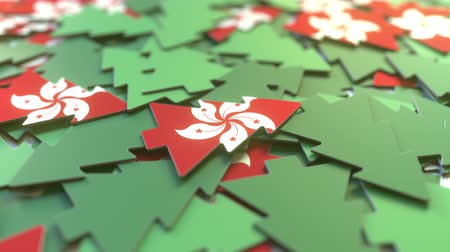 suvenýr : Details of flag of Hong Kong on the cardboard Christmas trees. Winter holidays related 3D animation Dostupné videozáznamy